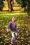 Autumn fun, happy child Stock Images