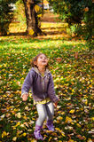 Autumn fun, happy child Royalty Free Stock Photo