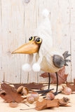 Autumn funny bird. Funny bird in warm hat with oak acorns. Autumn decoration Stock Photography