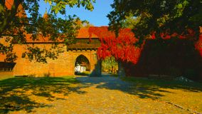 Autumn in the garden. Old building in Poland. The color of the wall is red in the traditional style.  stock photo