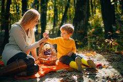 Autumn garden party mather and son. Camping with kids. We like autumn time together. Childhood friendship and first. Memories. Camping with kids royalty free stock image