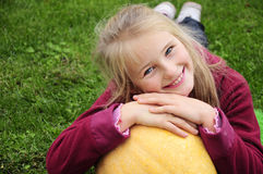 Autumn gardening - lovely girl with pumpkin Royalty Free Stock Photos