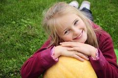 Autumn gardening - lovely girl with pumpkin Royalty Free Stock Photos
