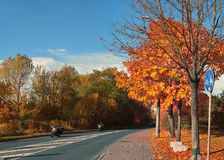 Autumn in Germany - the street with the motorcycle Royalty Free Stock Photo