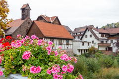 Autumn Gernsbach city landscape in Germany. Autumn city landscape with blossoming geranium on Murg river bridge in Gernsbach, Germany Stock Photo
