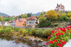 Autumn Gernsbach city landscape in Germany. Autumn city landscape with blossoming geranium on Murg river bridge in Gernsbach, Germany Royalty Free Stock Images