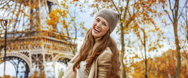 Happy young tourist woman near Eiffel tower having fun time Stock Photo