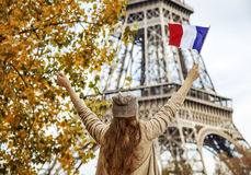 Elegant woman on embankment in Paris, France rising flag Stock Photography