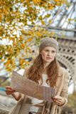 Young tourist woman on embankment in Paris, France with map Stock Photos
