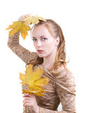 Autumn girl. Young woman with maple leaves Royalty Free Stock Images