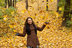 Autumn girl. Young woman with autumn yellow background stock photography