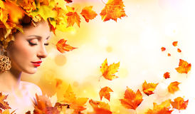 Autumn Girl - Beauty Model Woman With Orange Leaves stock images