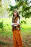 Autumn girl with flower wreath in her hands and in fur coat outdoors Royalty Free Stock Image