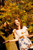 Autumn girl having fun Royalty Free Stock Photography