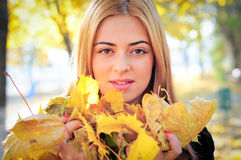 Autumn girl leaf royalty free stock images