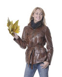 Autumn girl with leaves. Smiling girl with autumn leaves on hand Royalty Free Stock Images