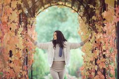 Autumn girl portrait in city park outdoors. Autumn girl playing in city park. Fall woman portrait of happy lovely and beautiful mixed race Asian Caucasian young Stock Photography