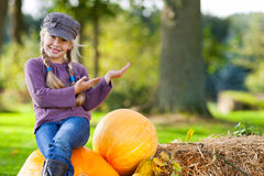 Autumn girl presenting copy space Royalty Free Stock Photography