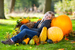 Autumn girl with pumpkin Stock Photos