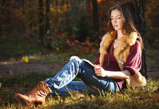 Autumn girl reading a book Royalty Free Stock Photography