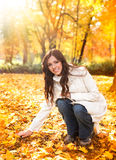 Autumn girl. Smiling young woman in autumn park royalty free stock photography
