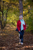 Autumn girl with sunglases in the park Royalty Free Stock Photo