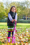 Autumn girl with umbrella Stock Photos