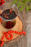 Autumn in a glass of mulled wine Stock Photo