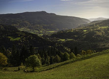 Autumn glory. Autumn in the Valdres area of Norway. A valley filled with soft autumn light stock image