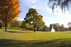 Autumn Golf. The golf course fairway with Autumn Colors. Fountain hazard ahead Stock Photo