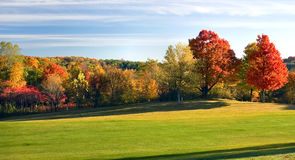 Autumn Golf Fairway. Long shadows on the golf course fairway in autumn. Wisconsin in the fall is cool and colorful Stock Image