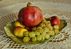 Autumn grape, pomegranate and apple fruits on wool background Royalty Free Stock Photography
