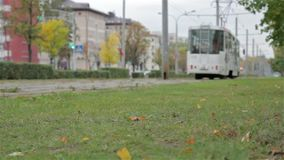 Autumn grass on the tramway background. Horizontal, slider shot.  stock footage