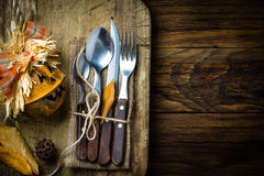 Autumn Halloween composition. Rustic set of cutlery knife, spoon, fork. Stock Image