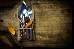 Autumn Halloween composition. Rustic set of cutlery knife, spoon, fork. Royalty Free Stock Photography