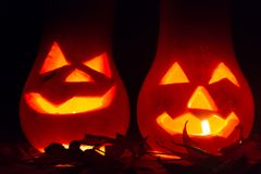 Autumn and halloween decoration with pumpkins carved in the candlelight in the dark Royalty Free Stock Photos