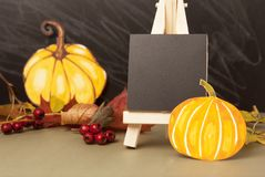 Autumn, halloween pumpkins and mini blackboard chalkboard and maple leaves. Grey backgroud, copy space. Autumn, halloween pumpkins and mini blackboard stock photos