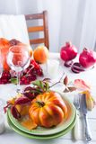 Autumn Halloween or thanksgiving day table setting. Fallen leaves, pumpkins, spices, empty plate and cutlery on wooden. Table. Thanksgiving background mock up royalty free stock images