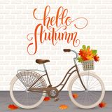 Autumn hand drawn lettering. Retro bicycle with basket of leaves. Healthy lifestyle, fitness Royalty Free Stock Photography