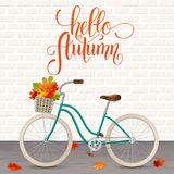 Autumn hand drawn lettering. Retro bicycle with basket of leaves. Healthy lifestyle, fitness Stock Image