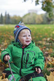Autumn happy baby. Happy baby in autumn leaves Royalty Free Stock Photography