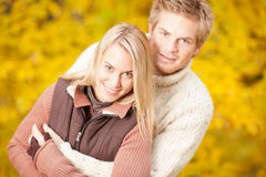 Autumn happy couple hugging together in park Stock Images