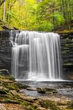 Autumn at Harrison Wright Falls. Harrison Wright Falls, a very beautiful plunging waterfall in Pennsylvania`s Ricketts Glen State Park, is topped here by stock photography