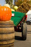 Autumn harvest. Rural cart with pumpkins and straws pack in city fair Stock Photography