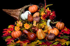 Autumn harvest. Cornucopia full of season harvest royalty free stock image