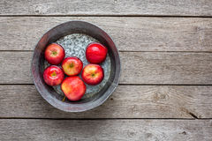Metal basin with apples in water. Autumn harvest background Royalty Free Stock Photo