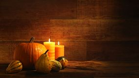 Autumn harvest candles and Pumkins on retro wood background video. This is a close-up photograph symbolizing Thanksgiving, fall, autumn, using candles and