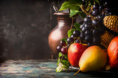 Autumn harvest concept. Fall fruits and vegetables on dark rustic kitchen table Royalty Free Stock Image