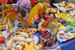 Autumn harvest festival. Lugansk, Ukraine - Oktober 11, 2016. Sale of sweets and food on a table. Autumn harvest festival at the kindergarten. Ukraine royalty free stock photo