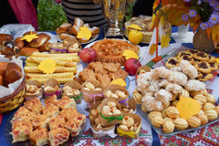 Autumn harvest festival. Lugansk, Ukraine - Oktober 11, 2016. Sale of sweets and food on a table. Autumn harvest festival at the kindergarten. Ukraine Stock Image